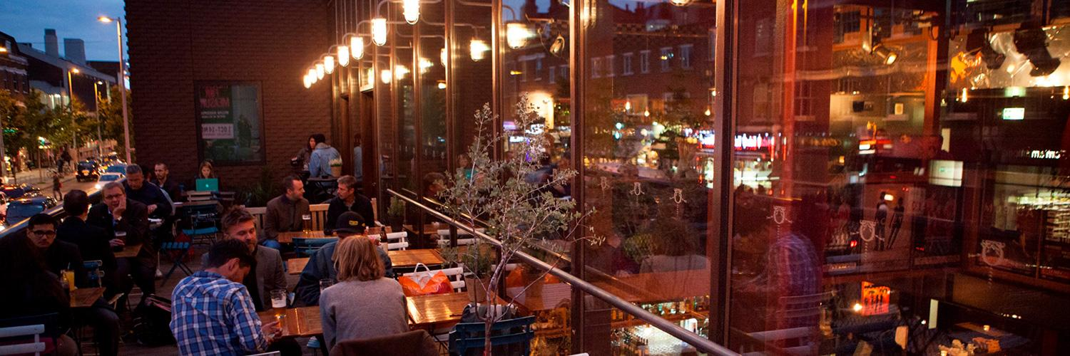 The Cut Bar's terrace in the evening with people seated and drinking
