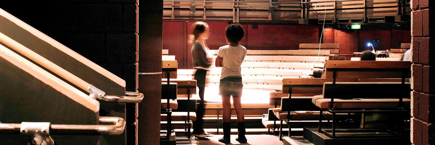 Two young people seen through the door to the main auditorium. Picture by Philip Vile