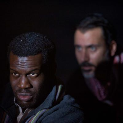 Ansu Kabia (Mohammed) and Ben Turner (Salar) in The Jungle at the Young Vic © David Sandison