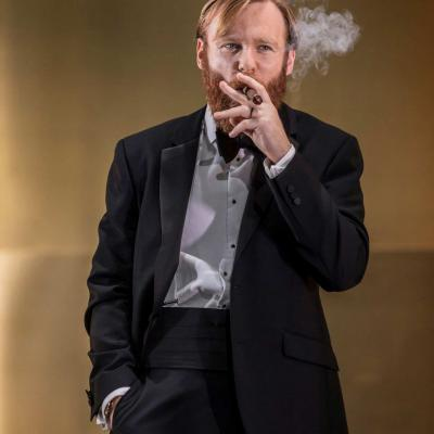 Brian Gleeson (Gooper) smokes a cigar in Cat on a Hot Tin Roof