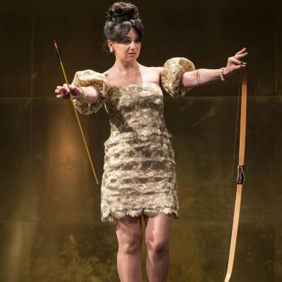 Hayley Squires (Mae) holds a bow and arrow Cat on a Hot Tin Roof