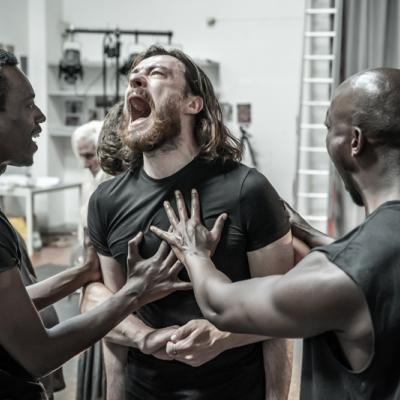 Faaiz Mbelizi, Gavin Drea and Roger Jean Nsengiyumva in rehearsals for Blood Wedding. Young Vic 2019. Photo by Marc Brenner.