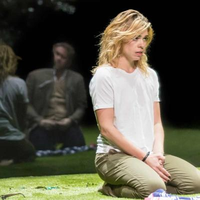 Billie Piper (Her) kneels on the grass in Yerma at the Young Vic by Johan Persson