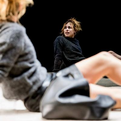Billie Piper (Her) looks at a reflection of herself in the glass in Yerma at the Young Vic by Johan Persson