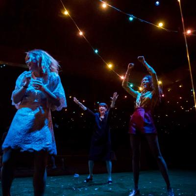 Billie Piper, Maureen Beattie and Thalissa Teixeria in a party scene in Yerma at the Young Vic. Photo by Johan Persson