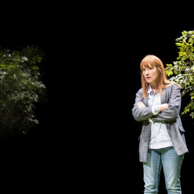 Charlotte Randle (Mary) stands between two trees in Yerma at the Young Vic. Photo by Johan Persson