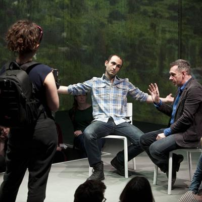 Khalid Abdalla and Paul Mason in Why It's Kicking Off Everywhere at the Young Vic. Photo by David Sandison.