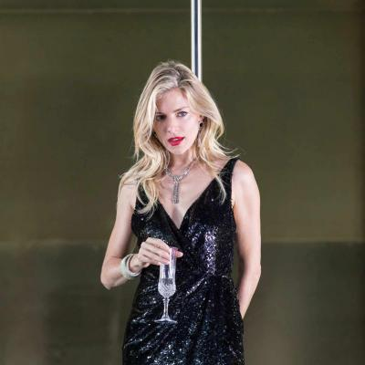 Sienna Miller (Maggie) in a black dress holds a champagne glass Cat on a Hot Tin Roof