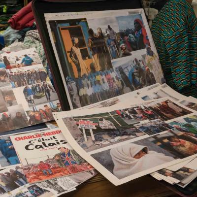 Mood boards in the YV Wardrobe department made up of images of refugees in camps in people in their native land.