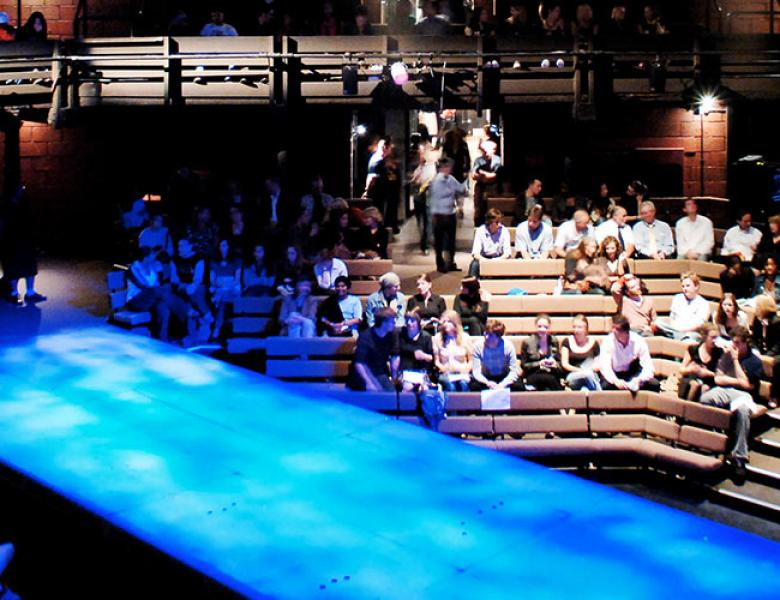 Interior of Young Vic auditorium with audience members before a performance