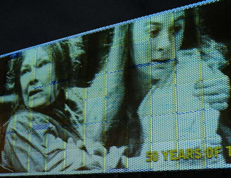 A photo of Judi Dench and Niamh Cusack in Sam Mendes' 1991 revival of The Plough and the Stars in projected on the Young Vic