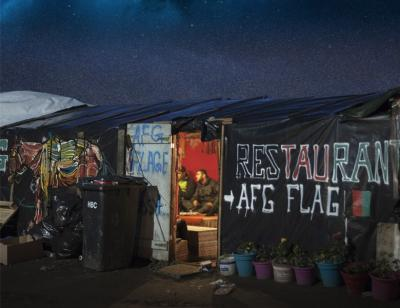 The Afghan cafe in 'The Jungle' below a starry night sky